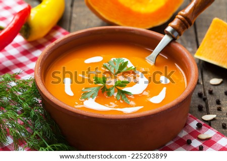 Squash soup in rustic bowl - stock photo