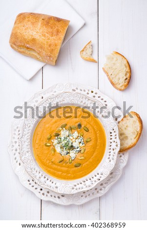 Squash Soup with Blue Cheese, Thyme and Bread top view - stock photo