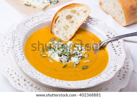 Squash Soup with Blue Cheese, Thyme and Slice of Bread - stock photo