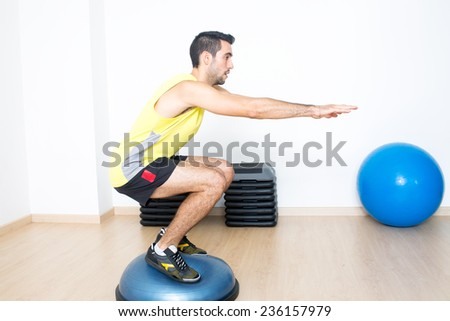 Squat on platform - stock photo