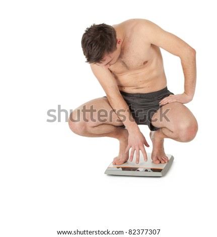 squats on scale - stock photo