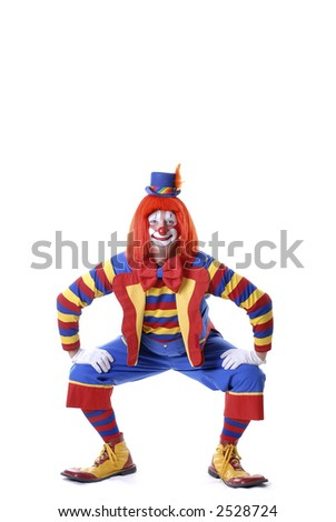 Squatting Clown - stock photo