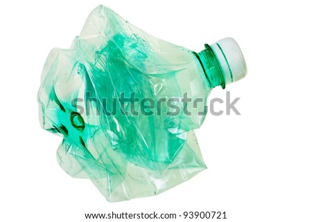Squeezed green PET bottle ready for recycling isolated over white background.