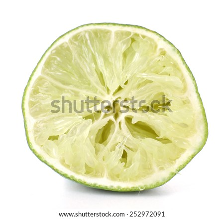 Squeezed lime isolated on white - stock photo