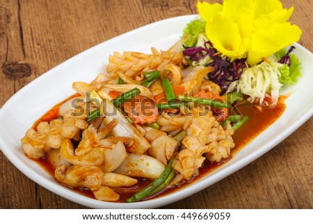 Squid in sauce with spices - Asian cuisine