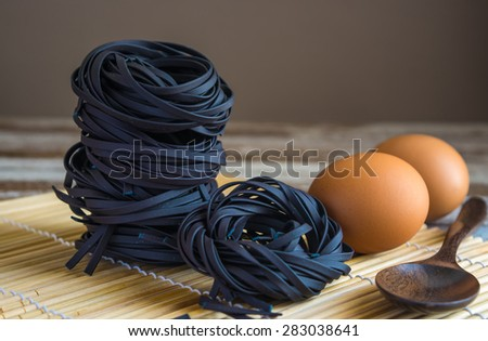 Squid ink black tinted twirl of a tagliatelle. - stock photo