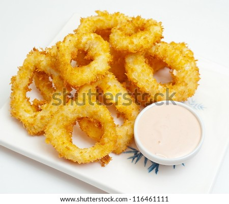 squid rings, fried in batter with a mayonnaise bowl