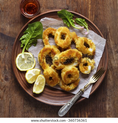 Squid rings, Fried in egg and Lemon. Healthy Mediterranean Appetizer . - stock photo