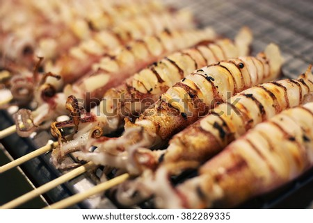 Squid skewer at market - stock photo