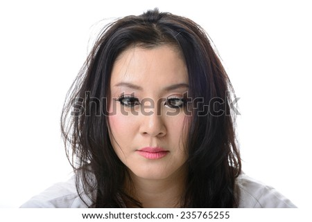 squint eyed crazy asian woman isolated on white - stock photo