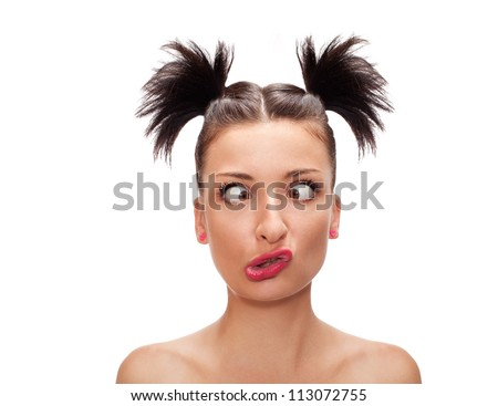 squint eyed woman with weird expression isolated on white - stock photo