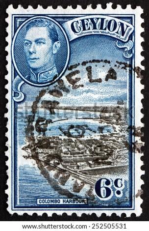 SRI LANKA - CIRCA 1946: a stamp printed in Sri Lanka shows View of Colombo Harbor and Portrait of King George VI, circa 1946 - stock photo
