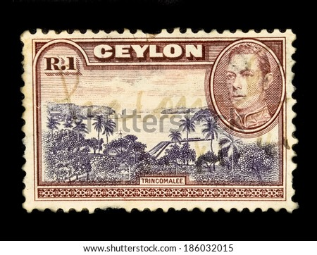 SRI LANKA-CIRCA 1937: An old Ceylon postal stamp shows image of Trincomalee & King George VI, circa 1937