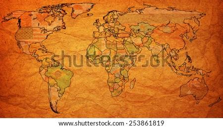 sri lanka flag on old vintage world map with national borders - stock photo