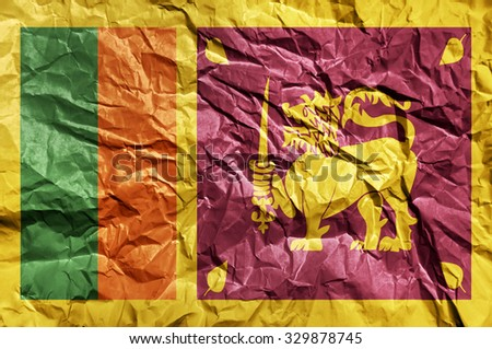 Sri Lanka flag painted on crumpled paper background - stock photo