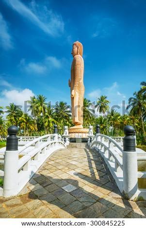 Sri Lanka. Hikkaduwa. The obelisk in memory of the Buddha died during the tsunami - stock photo