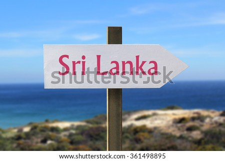 Sri Lanka sign with seashore in the background
