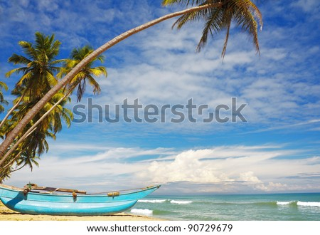 Sri-Lanka sunny coast with fishers boat - stock photo