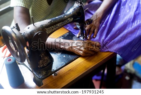 Sri Lankan tailor making new clothes - stock photo