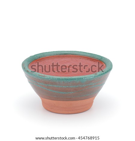 Sriracha Hot chilli Sauce in a clay sauce-boat isolated on white background - stock photo