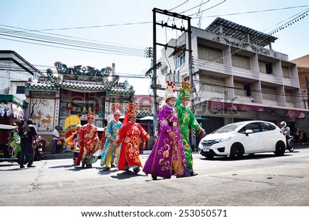 SRIRACHA, THAILAND -  FEBRUARY 5 : Chinese opera actors walking across the street to offering Shrine of the Black Sea on February 5, 2015 in  Sriracha, Chonburi, Thailand - stock photo
