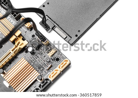 SSD hard drive with cable connected to motherboard.  Concept of cloud drive, or communications. - stock photo