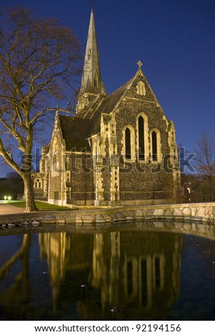 St. Alban's Anglican Church in Copenhagen, Denmark in the night reflected in water - stock photo