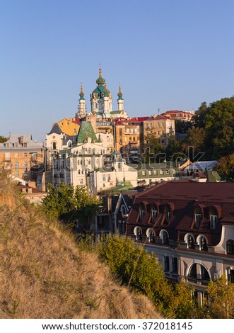 St. Andrew's Church and the old houses on the St. Andrew's Descent. Kiev, Ukraine - stock photo