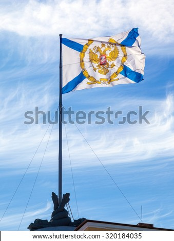 St. Andrew's flag on the Admiralty building in St. Petersburg, Russia - stock photo