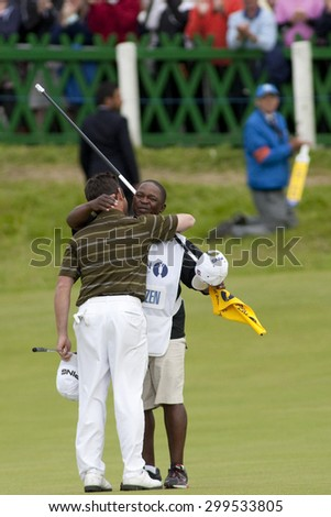 ST ANDREWS, SCOTLAND. July 18 2010: Louis OOSTHUIZEN from South Africa hugs his caddie after winning The Open Championship    played on The Royal and Ancient Old Course - stock photo