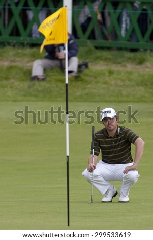 ST ANDREWS, SCOTLAND. July 18 2010: Louis OOSTHUIZEN from South Africa lines up the winning putt on his way to winning The Open Championship    played on The Royal and Ancient Old Course - stock photo