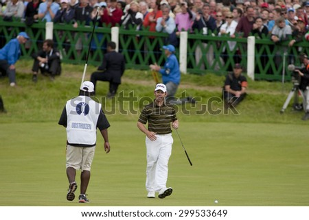 ST ANDREWS, SCOTLAND. July 18 2010: Louis OOSTHUIZEN from South Africa on his way to winning The Open Championship    played on The Royal and Ancient Old Course - stock photo
