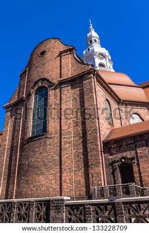 St. Anne's Parish Church in Nikiszowiec, one of the districts of Katowice, Silesia region, Poland. The place is historic coal miners' settlement built between 1908-1918. - stock photo