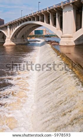 St Anthony Falls and 3rd Avenue Bridge - Minneapolis, Minnesota - stock photo