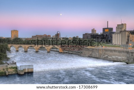 St Anthony Falls, Minneapolis, MN - dusk with rising moon - HDR (High Dynamic Range) image - stock photo