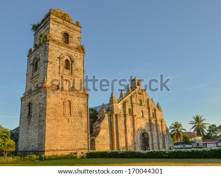 St. Augustine Church and Bell Tower - Paoay, Ilocos Norte, Philippines - stock photo