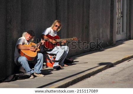 ST. AUGUSTINE, FL - APRIL 12: Street musicians play for passersby in the old colonial district April 12, 2014 in St. Augustine, FL. - stock photo
