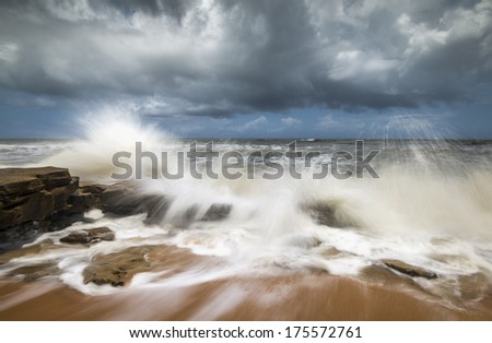 St. Augustine FL Beach Seascape Crashing Ocean Waves on the coquina rocks at Washington Oaks State Park Florida along the east coast Atlantic Ocean - stock photo
