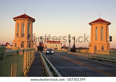 St. Augustine - taxi on the old bridge at sunrise - stock photo