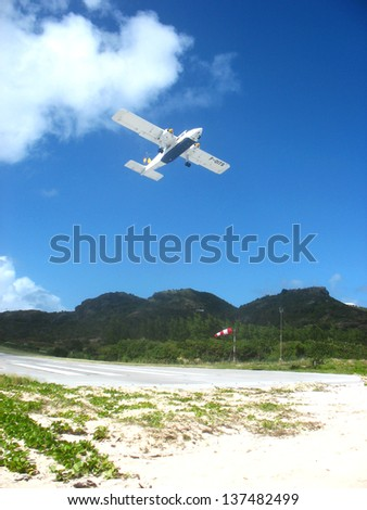 ST. BARTS, FRENCH WEST INDIES - JANUARY 19: Small plane taking off from St Barts airport on January 19, 2006. St. Barts is considered a playground of the rich and famous.