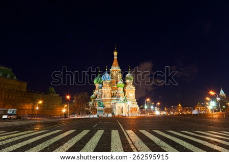 St. Basil's Cathedral and foot transition zebra in the foreground, night. Moscow - stock photo