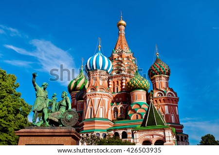 St. Basil's Cathedral on Red square in Moscow. Monument of Minin and Pozharsky in Moscow, Russia. Main attractions of Moscow city - stock photo
