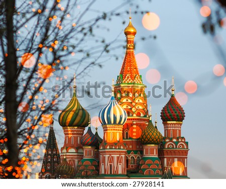 St. Basil's Cathedral through trees with lamps in bokeh (out of focus)