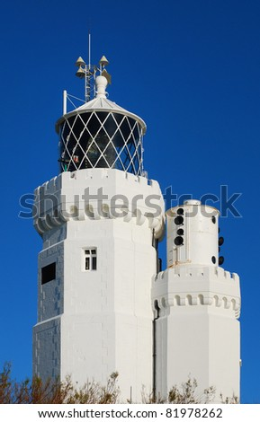 St. Catherine's Lighthouse on the Isle of Wight on a clear day. - stock photo