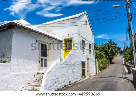 ST.GEORGEâ??S, BERMUDA, MAY 27 - A rustic white home along a rural road on May 27 2016 in St. Georgeâ??s Bermuda.  - stock photo
