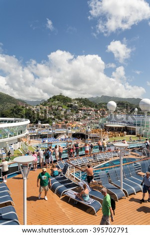 ST. GEORGE'S, GRENADA - FEBRUARY 2, 2015: Two large cruise ships full of tourists dock at the Capital City of this island who is a very popular destination in winter.