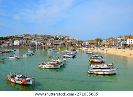 ST IVES, CORNWALL, UK - 18 July 2013 : Fishing and pleasure boats in the Harbour at St Ives
