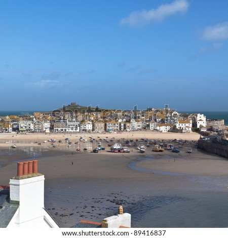 St Ives in Cornwall at low tide looking across the roof tops - stock photo