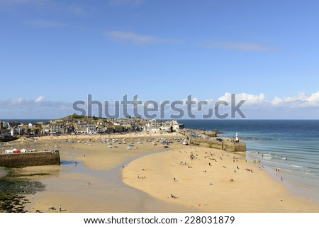 St. IVES, UNITED KINGDOM - AUGUST 17 people walk in the dry harbor at week end at low tide time, shot on 2014 august 17, St. Ives , Cornwall, United Kingdom