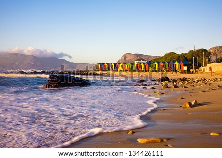 St James beach with its colorful bathing boxes in Cape Town, South Africa. - stock photo
